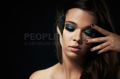 Buy stock photo Shot of a beautiful young woman with her eyes closed and dramatic makeup