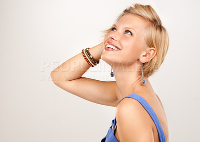 Buy stock photo An attractive young woman touching her hair