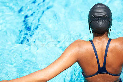 Buy stock photo Rearview of a young female swimmer getting ready to dive into the pool