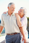 Loving senior woman embracing her happy husband from behind