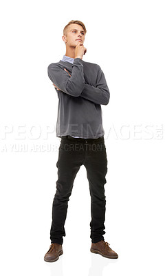 Buy stock photo Full length studio shot of a young man looking thoughtful isolated on white