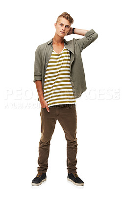 Buy stock photo A full length studio shot of a stylishly dressed young man with one hand behind his head
