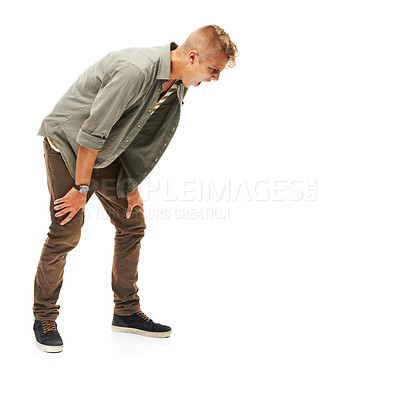 Buy stock photo A full length studio shot of a man motioning like he is yelling or being sick isolated on white
