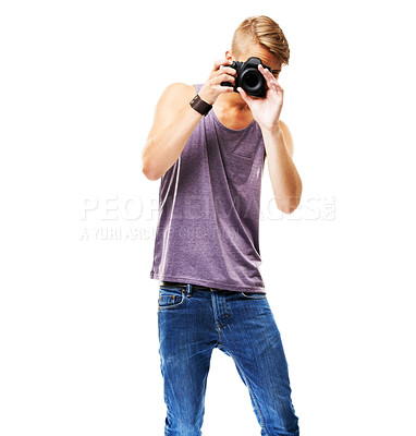 Buy stock photo Studio shot of a casually dressed young man pointing a camera at the photographer isolated on white
