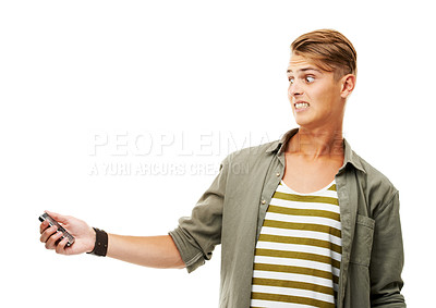 Buy stock photo Studio shot of a young man holding a cellphone and reacting to a text message isolated on white