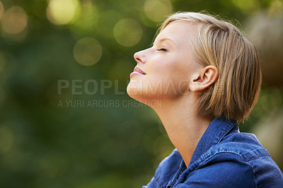 Buy stock photo A young woman outdoors with her eyes closed beside copyspace