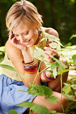 Buy stock photo An attractive young woman enjoying the plants out in nature