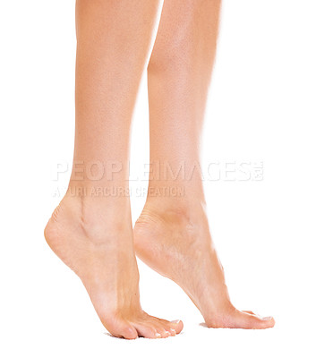Buy stock photo Closeup of a young woman's feet standing on her tiptoes