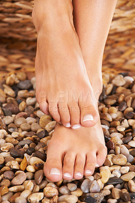 Buy stock photo Closeup of feet on stones in a spa
