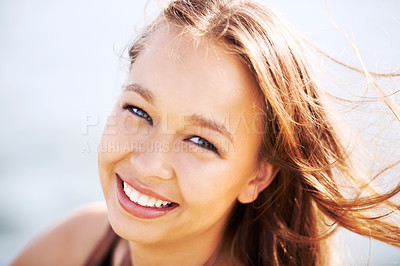 Buy stock photo A stunning young woman smiling at the camera