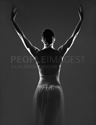 Buy stock photo Silhouette of a young ballerina dancing against a dark background