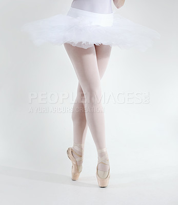 Buy stock photo Cropped view of a young ballerina's legs as she dances en pointe