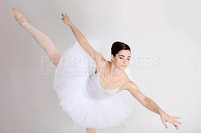 Buy stock photo Beautiful young ballerina in costume while dancing against a white background