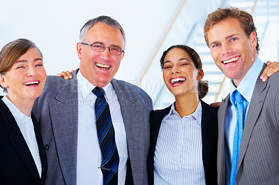 Buy stock photo Portrait of a diverse workgroup having a laugh.