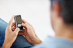 Closeup of normal guy typing text message on mobile phone