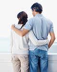 Loving couple standing with arms around  each other