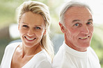 Closeup of a happy mature couple back to back