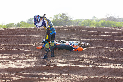 Buy stock photo A motocross rider getting up after crashing