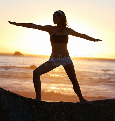 Buy stock photo Silhouette of a young woman doing a pilates pose at the beach