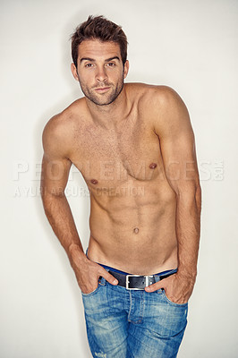 Buy stock photo Muscular young guy standing shirtless in denim shorts while against a white background
