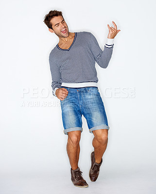 Buy stock photo Handsome young guy playing air guitar while against a white background