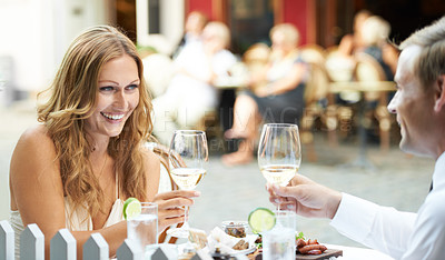 Buy stock photo A beautiful woman gives a toast in a restaurant and smiles