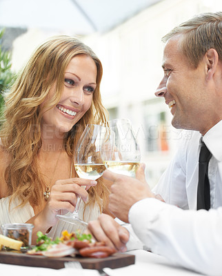 Buy stock photo A gorgeous couple toast at a restaurant