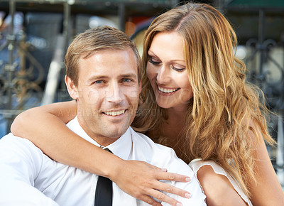 Buy stock photo A portrait of a handsome man with his girfriend embracing him