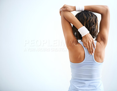 Buy stock photo Rear view of a woman stretching alongside copyspace