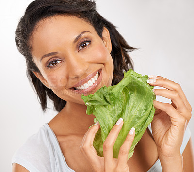 Buy stock photo Portrait of a young woman enjoying a healthy snack