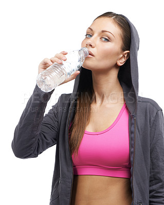 Buy stock photo A fit young woman in a hoodie drinking water after a workout