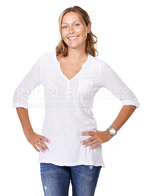 Buy stock photo A young woman smiling at the camera with her hand on her hip