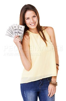 Buy stock photo Studio shot of an attractive young woman  holding up fanned out banknotes isolated on white