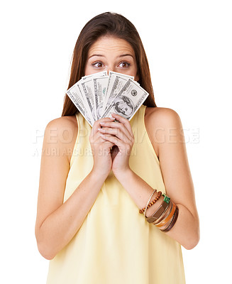 Buy stock photo Studio shot of an attractive young woman holding up fanned out banknotes in front of her face isolated on white