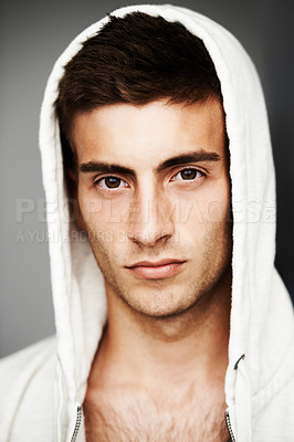 Buy stock photo Portrait of a good looking man with his hoodie on