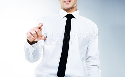Buy stock photo A cropped image of a business man pointing at the camera