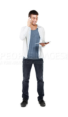 Buy stock photo Full length image of a casual male talking on his cellphone whilst holding his touchscreen