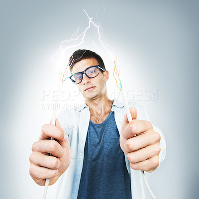 Buy stock photo A technician holding up some frayed wires