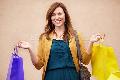 Buy stock photo Cropped shot of an attractive young woman with shopping bags