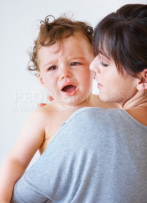 Buy stock photo Shot of a mother comforting her crying baby