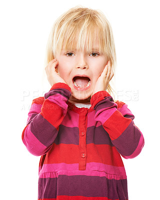 Buy stock photo Studio shot of a little blonde girl standing with her head in her hands looking scared