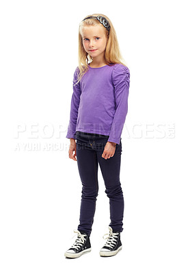 Buy stock photo Full length shot of a little girl looking at the camera in a white studio