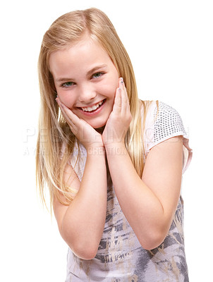 Buy stock photo Sweet young girl posing for the camera in a white studio