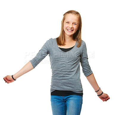Buy stock photo Studio portrait of a happy teenage girl standing against a white background
