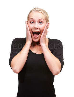 Buy stock photo An attractive young woman expressing great surprise against a white background
