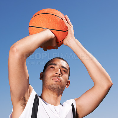 Buy stock photo A young basketball player preparing a shot
