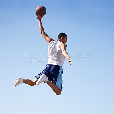 Buy stock photo A young athlete taking a flying jump