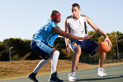 Buy stock photo Two professional basketball players opposing each other