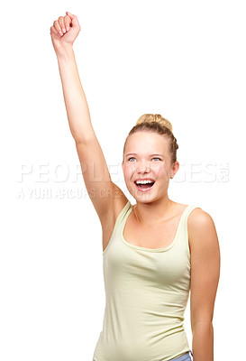 Buy stock photo A pretty teenage girl standing with one hand in the air in a cheering gesture