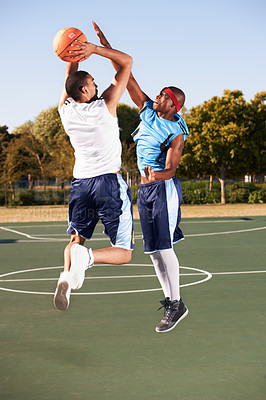 Buy stock photo Two basketball players jumping for the ball